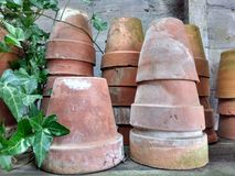Terracotta plant pots. Stacks of terracotta plant pots in garden shed Royalty Free Stock Photos