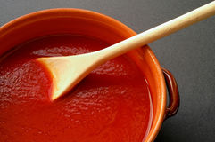 Terracotta pot and wooden spoon Royalty Free Stock Photography