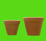 Terracotta Pots. 2 flower pots on green background stock photography