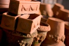 Terracotta pots. Pile of molded terracotta pots, shallow dof royalty free stock images