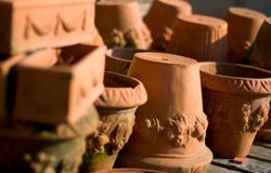 Terracotta pots. Pile of terracotta pots, ona wooden bench, with some mold. Please see portfolio for more stock photo