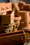 Terracotta pots. Pile of terracotta pots, ona wooden bench, with some mold. Please see portfolio for more stock photos