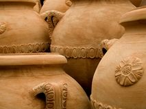 Terracotta pots. Terracotta jars on display outside a crafts workshop in Tuscany, Italy. Once used for storing olive oil , these large unglazed clay vases are Stock Image