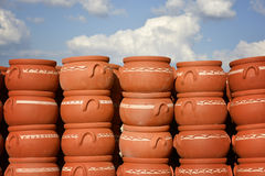 Terracotta pottery. Handmade crafts of terracotta pots, casserole pots overlapping under the sky Royalty Free Stock Photography