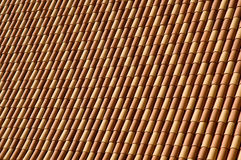 Terracotta roof tiles. A view of terracotta roof tiles on a roof. Suitable for an abstract background royalty free stock images