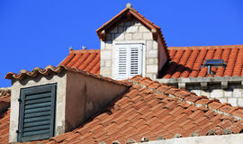 Terracotta roofs and dormer windows with shutters Royalty Free Stock Image