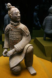 Terracotta sculpture of the an. The Chinese terracotta soldier is dressed in chain armour and costs on one knee Royalty Free Stock Photos