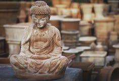 Terracotta statue of buddha Stock Photo