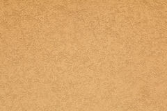 Terracotta stucco wall. Background texture Stock Photography
