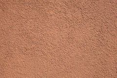 Terracotta stucco wall. Detail of terracotta stucco wall Stock Photography