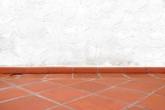 Terracotta Tailed Floor and White Concrete Wall Royalty Free Stock Image