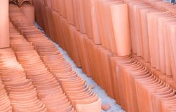Terracotta Tile. New terracotta roof tile stacked at construction site Stock Photo