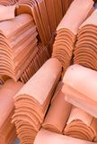 Terracotta Tile. New terracotta roof tile stacked at construction site Royalty Free Stock Photography
