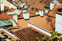 Terracotta tiled roofs with chimneys Stock Image