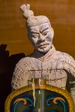 Terracotta warrior. Close up of terracotta warrior holding a wooden shield Stock Images
