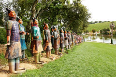 Terracotta Warriors. In a garden alongside the calm face of the lake Stock Images