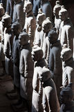 Terracotta warriors lit by sun light Stock Photography