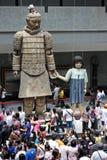 Terracotta warriors museum, Xian. Big terracotta warrior Statue holding hands with a girl puppet in the Terracotta warriors museum in Xian, China Royalty Free Stock Photos