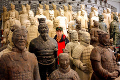Terracotta Warriors. Tourist in between the Terracotta Warriors. The Terracotta Army or the Terracotta Warriors and Horses is a collection of terracotta royalty free stock photography