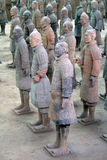 Terracotta warriors in Xian, C. This is the 1st Pit of the Terracotta Army archaeological site in Xian China. The warriors used to hold spears and arches Royalty Free Stock Images