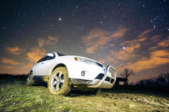 Terrain car in a countryside landscape with muddy road and grass Stock Photography