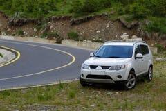 Terrain car near the road Stock Photos