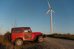 Terrain car at windmills Royalty Free Stock Photos