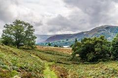 Terrain communal orageux d'Ullswater et de Bampton photos stock