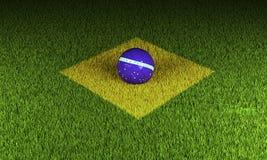 Terrain de football avec le drapeau brésilien Photographie stock libre de droits