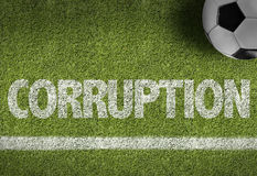 Terrain de football avec le texte : Corruption Images stock