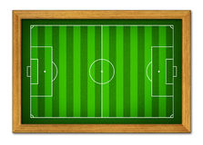 Terrain de football dans le cadre en bois. Image stock