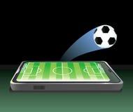 Terrain de football dans le téléphone portable. Images libres de droits