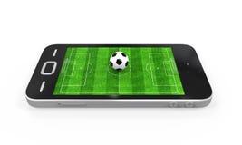Terrain de football dans le téléphone portable Photographie stock libre de droits