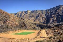 Terrain de football dans les montagnes Photo libre de droits