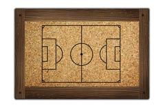 Terrain de football sur la trame en bois Photographie stock