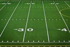 Terrain de football vide Photos stock