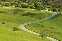Terrain de golf pendant le lever de soleil Photos stock