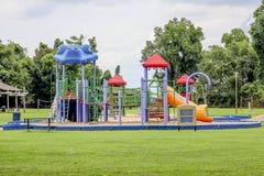 Terrain de jeu au parc local Photographie stock libre de droits