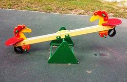 Terrain de jeu coloré sur la cour Photos stock