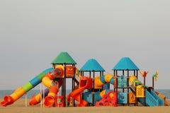 Terrain de jeu d'enfants sur la plage Photos stock
