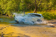 Terrain vehicle crosses the stream Royalty Free Stock Photo