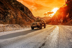 Terrain vehicle mountains. Terrain vehicle in the mountains. Big Almaty gorge, the height of 2000 m Royalty Free Stock Photography