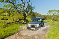 Terrain vehicle on the muddy road Royalty Free Stock Photography