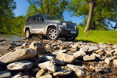 Terrain vehicle over a stream royalty free stock photo