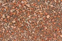Terrakotta-Hintergrund von kleinen Steinen Steine vom Ätna T Lizenzfreies Stockfoto