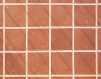 Terrakottabodenquadratfliesen-Hintergrundbeschaffenheit Stockfotografie
