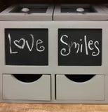 Terraplén del envase con amor y sonrisas Imagen de archivo libre de regalías