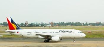 Terras filipinos do jato das linhas aéreas em Vietnam. Imagem de Stock