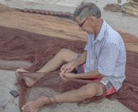 Terrasini i 10 oct. 2018.Fisherman at work royalty free stock photos