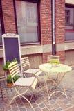 terrass för stolskaffetabeller Arkivfoto